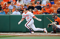 Clemson Tigers  second baseman Steve Wilkerson #17 swings at a pitch during a game against the Virginia Cavaliers  at Doug Kingsmore Stadium on March 15, 2013 in Clemson, South Carolina. The Cavaliers won 6-5.(Tony Farlow/Four Seam Images).