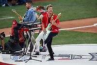 Cincinnati, Ohio based Walk the Moon - Nicholas Petricca (center), Eli Maiman (left), and Kevin Ray (right) - perform before the MLB Home Run Derby on July 13, 2015 at Great American Ball Park in Cincinnati, Ohio.  (Mike Janes/Four Seam Images)