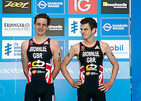 12 JUL 2014 - HAMBURG, GER - Race winner Alistair Brownlee (GBR) (left) from Great Britain waits with bronze medalist, his brother and team mate Jonathan Brownlee (GBR) (right), for the start of the medal ceremony for the elite men's 2014 ITU World Triathlon Series round in the Altstadt Quarter in Hamburg, Germany (PHOTO COPYRIGHT © 2014 NIGEL FARROW, ALL RIGHTS RESERVED)