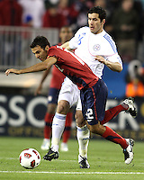 Jonathan Bornstein(12) of the USA MNT is tackled by Marcos Riveros(16) of Paraguay during an international friendly match at LP Field, in Nashville, TN. on March 29, 2011.Paraguay won 1-0.