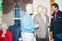 """People talk after hearing Texas senator and Republican presidential candidate Ted Cruz speak to attendees at an event called """"Smoke a cigar with Ted Cruz"""" at a house party at the home of Linda & Steven Goddu Salem, New Hampshire."""