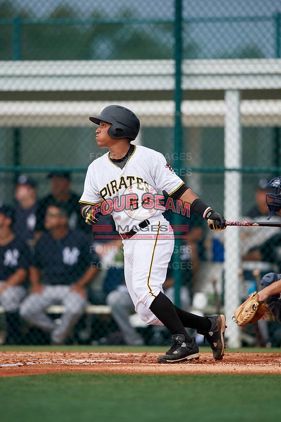 GCL Pirates catcher Samuel Inoa (54) follows through on a swing during the first game of a doubleheader against the GCL Yankees East on July 31, 2018 at Pirate City Complex in Bradenton, Florida.  GCL Yankees East defeated GCL Pirates 2-0.  (Mike Janes/Four Seam Images)