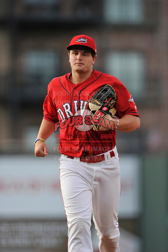 Center fielder Tate Matheny (16) of the Greenville Drive runs in from the outfield in a game against the Columbia Fireflies on Friday, April 22, 2016, at Fluor Field at the West End in Greenville, South Carolina. Columbia won, 5-3. (Tom Priddy/Four Seam Images)