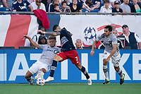 FOXBOROUGH, MA - JULY 25: Zorhan Bassong #19 of CF Montreal tackles Gustavo Bou #7 of New England Revolution during a game between CF Montreal and New England Revolution at Gillette Stadium on July 25, 2021 in Foxborough, Massachusetts.