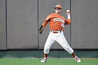 Texas Longhorns outfielder Mark Payton #15 throws the ball to the infield against the Texas A&M Aggies in NCAA Big XII Conference baseball on May 21, 2011 at Disch Falk Field in Austin, Texas. (Photo by Andrew Woolley / Four Seam Images)