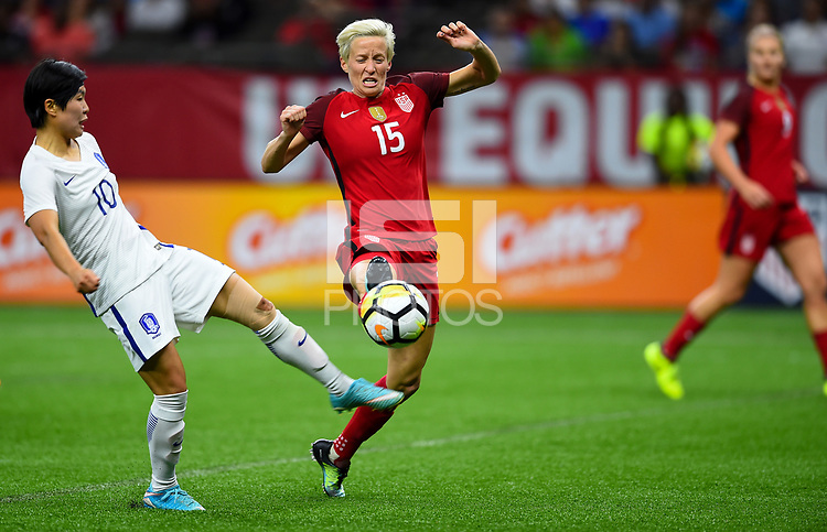 New Orleans, LA - Thursday October 19, 2017: Ji Soyum, Megan Rapinoe during an International friendly match between the Women's National teams of the United States (USA) and South Korea (KOR) at Mercedes Benz Superdome.