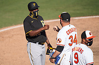 Pittsburgh Pirates coach Tarrik Brock (16) fist bumps Tim Cossins (34) after a Major League Spring Training game against the Baltimore Orioles on February 28, 2021 at Ed Smith Stadium in Sarasota, Florida.  (Mike Janes/Four Seam Images)