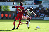 Sammy Ameobi of Nottingham Forest battles with Andre Ayew of Swansea City during the Sky Bet Championship match between Swansea City and Nottingham Forest at the Liberty Stadium in Swansea, Wales, UK. Saturday 14 September 2019