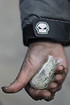 © Joel Goodman - 07973 332324 . 06/04/2017 . Manchester , UK . A homeless man holds out his hand to show a bag of spice he says he has bought for £20 , which he describes as a single day's supply for himself . An epidemic of abuse of the drug spice by some of Manchester's homeless population , in plain sight , is causing users to experience psychosis and a zombie-like state and is daily being witnessed in the Piccadilly Gardens area of Manchester , drawing large resource from paramedic services in the city centre . Photo credit : Joel Goodman
