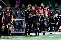 ATLANTA, GA - APRIL 24: Atlanta United coach Gabriel Heinze discusses strategy with #7 Josef Martinez prior to substitution during a game between Chicago Fire FC and Atlanta United FC at Mercedes-Benz Stadium on April 24, 2021 in Atlanta, Georgia.