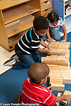 Education Preschool first days of school  3-4 year olds group of two boys and a girl building with wooden blocks