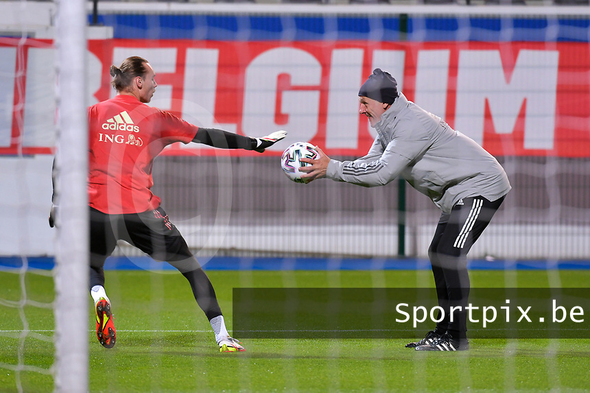 Goalkeeper Maarten Vandevoordt (1) of Belgium and goalkeeper coach Filip De Wilde pictured the warm up before during a soccer game between the national teams Under21 Youth teams of Belgium and Denmark on the fourth matday in group I for the qualification for the Under 21 EURO 2023 , on tuesday 12 th of october 2021  in Leuven , Belgium . PHOTO SPORTPIX | STIJN AUDOOREN