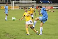 Yael Averbuch (13) of Sky Blue FC passes the ball as Angie Kerr (11) of the Atlanta Beat defends. Sky Blue FC defeated the Atlanta Beat 2-1 during a Women's Professional Soccer (WPS) match at KSU Atlanta Beat Stadium Kennesaw, GA, on August 7, 2010...