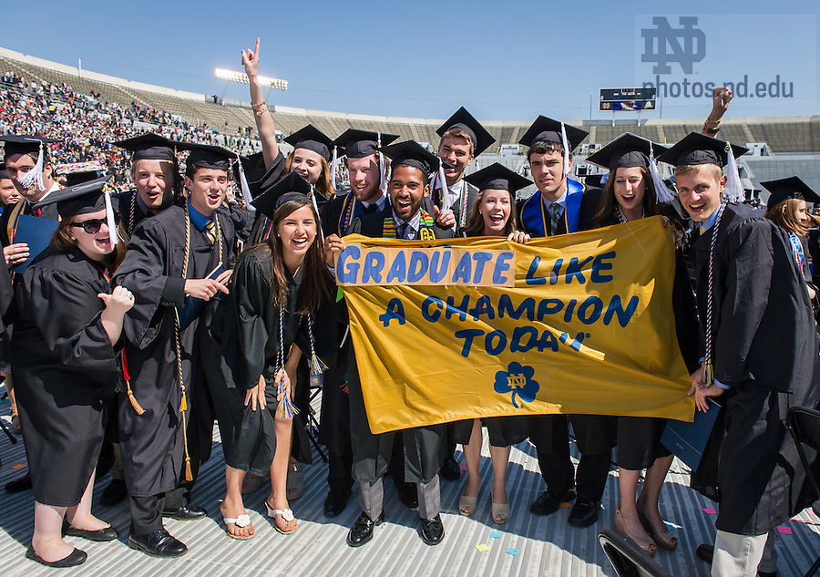 May 18, 2014; Graduates pose for photos following the 2014 Commencement ceremony in Notre Dame Stadium. Photo by Matt Cashore/University of Notre Dame