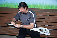 Chicago White Sox Minor League Strength and Conditioning Coordinator Dale Torborg puts a grip on the handle of a lacrosse goalie stick prior to the International League game between the Toledo Mud Hens and the Charlotte Knights at BB&T BallPark on April 24, 2019 in Charlotte, North Carolina. The Knights defeated the Mud Hens 9-6. (Brian Westerholt/Four Seam Images)
