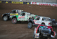 Nov. 5, 2011; Las Vegas, NV USA; LOORRS pro 2 unlimited driver Rob MacCachren (1) leads Robby Woods (99) and Rob Naughton (54)during round 13 at the Las Vegas Motor Speedway. Mandatory Credit: Mark J. Rebilas-US PRESSWIRE