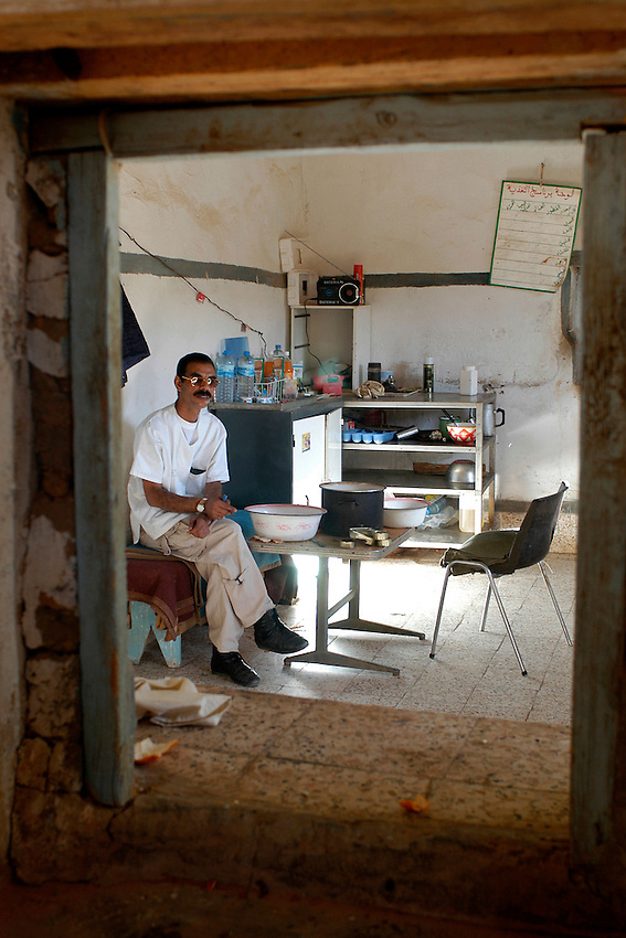 The chief of a hospital of the Ausserd wilaya repose on December 13, 2003. Saharawi people have been living at the refugee camps of the Algerian desert named Hamada, or desert of the deserts, for more than 30 years now. Saharawi people have suffered the consecuences of European colonialism and the war against occupation by Moroccan forces. Polisario and Moroccan Army are in conflict since 1975 when Hassan II, Moroccan King in 1975, sent more than 250.000 civilians and soldiers to colonize the Western Sahara when Spain left the country. Since 1991 they are in a peace process without any outcome so far. (Ander Gillenea / Bostok Photo)