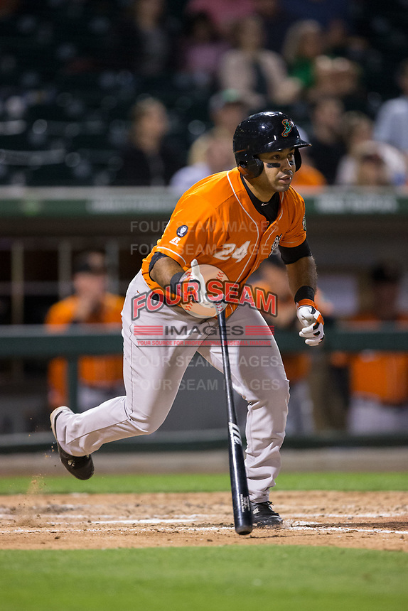 Pedro Alvarez (24) of the Norfolk Tides flips his bat as he starts down the first base line against the Charlotte Knights at BB&T BallPark on May 2, 2017 in Charlotte, North Carolina.  The Knights defeated the Tides 8-3.  (Brian Westerholt/Four Seam Images)