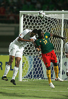 The United States' Tony Taylor (7) hits heads with Cameroon's Parfait Essengue (13) during the FIFA Under 20 World Cup Group C Match between the United States and Cameroon at the Mubarak Stadium on September 29, 2009 in Suez, Egypt.