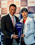 Hyo-Joo Kim of Korea receives the trophy from Tenniel Chu, Vice Chairman of Mission Hills Group, after winning the Hyundai China Ladies Open 2014 at World Cup Course in Mission Hills Shenzhen on December 14 2014, in Shenzhen, China. Photo by Aitor Alcalde / Power Sport Images