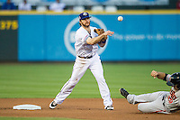 Round Rock Express shortstop Jason Donald (5) turns a double play during the Pacific Coast League baseball game against the Fresno Grizzlies on June 22, 2014 at the Dell Diamond in Round Rock, Texas. The Express defeated the Grizzlies 2-1. (Andrew Woolley/Four Seam Images)