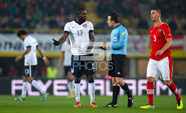 VIENNA, Austria - November 19, 2013: Jozy Altidore with referee Istvan Vad during a 0-1 loss to host Austria during the international friendly match between Austria and the USA at Ernst-Happel-Stadium.