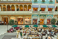 Dubai. United Arab Emirates. Mercato Shopping Mall, interior. Cafe? and shops. Italian style..
