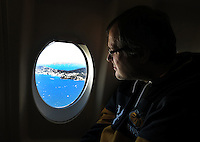 Photo: Richard Lane/Richard Lane Photography. Wasps rugby team and supporters travel to Toulon for the RC Toulon v Wasps.  European Rugby Champions Cup Quarter Final. 04/04/2015. A Wasps supporter watches the cote d'azur coast line as the plane nears Toulon airport.