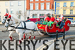 Listowel Parade:Santa Claus in his carriage pictured at the Annual Christmas parade in Lisowel on Sunday last .