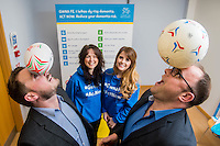 Friday 10 February 2017<br /> Pictured: ( L-R )  Rob morgan and Mike Attwell of BT balance balls on their heads during the event <br /> Re:Welsh Government Dementia Risk Prevention Roadshow at the BT building, Swansea, Wales, UK
