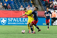 FOXBOROUGH, MA - AUGUST 4: Wilfrid Kaptoum #5 of New England Revolution yellow card tackle of Alex Muyl #19 of Nashville SC during a game between Nashville SC and New England Revolution at Gillette Stadium on August 4, 2021 in Foxborough, Massachusetts.