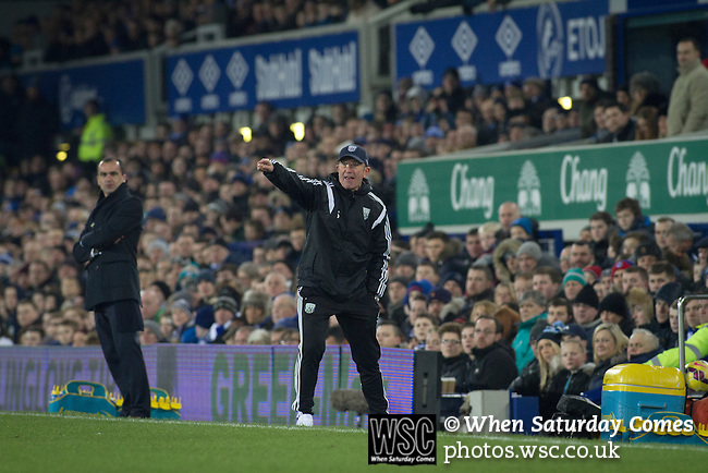 Everton 0 West Bromwich Albion 0, 19/01/2015. Goodison Park, Premier League. Opposing managers Roberto Martinez (left) and Tony Pulis giving differing reactions to an incident at Goodison Park, Liverpool during the Premier League match between Everton and West Bromwich Albion. The match ended in a 0-0 draw, despite the home team missing a first-half penalty by Kevin Mirallas. The game was watched by 34,739 spectators and left both teams languishing near the relegation zone. Photo by Colin McPherson.