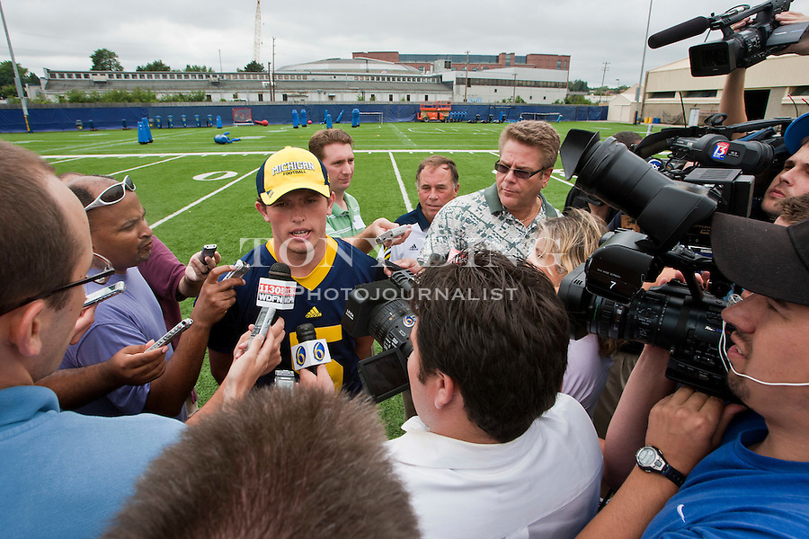 Michigan quarterback Tate Forcier, center, fields questions from reporters at the annual NCAA college football media day, Sunday, Aug. 22, 2010, in Ann Arbor, Mich. (AP Photo/Tony Ding)