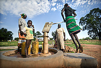 Children collect water from a tap in Tali Payam. Central Equatoria, South Sudan.