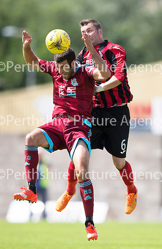 St Johnstone v Real Sociadad...12.07.15  Bayview, Methil (Home of East Fife FC)<br /> Tam Scobbie clears from Imanol Agirretxe<br /> Picture by Graeme Hart.<br /> Copyright Perthshire Picture Agency<br /> Tel: 01738 623350  Mobile: 07990 594431