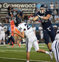 Greenwood's Beau Asher rushes Springdale Har-Ber quarterback Giovanni Caviasca in the first half of Friday's game against Springdale Har-Ber.