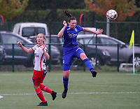 Genk's Caro Gielen (5) heads the ball away from Essevee's Laura Vervaecke (20) during a female soccer game between the women teams of Zulte Waregem A Dames and KRC Genk Ladies B on the 1/16 th qualifying round for the Belgian Womens Cup 2020  2021 , on saturday 26 th of September 2020  in Zulte , Belgium . PHOTO SPORTPIX.BE | SPP | SEVIL OKTEM