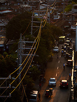 Last sunlight over electrical wires in the street of Mandaluyong, Manila, Philippines,