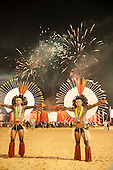 Karaja warriors pose in front of a firework display wearing their distinctive wheel-shaped feather headdresses at the International Indigenous Games in Brazil. 24th October 2015
