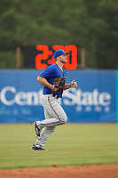 St. Lucie Mets left fielder Tim Tebow (15) jogs to the dugout during a game against the Florida Fire Frogs on July 23, 2017 at Osceola County Stadium in Kissimmee, Florida.  St. Lucie defeated Florida 3-2.  (Mike Janes/Four Seam Images)