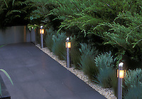 Built-in step lights and short pole lighting to illuminate garden path in evening