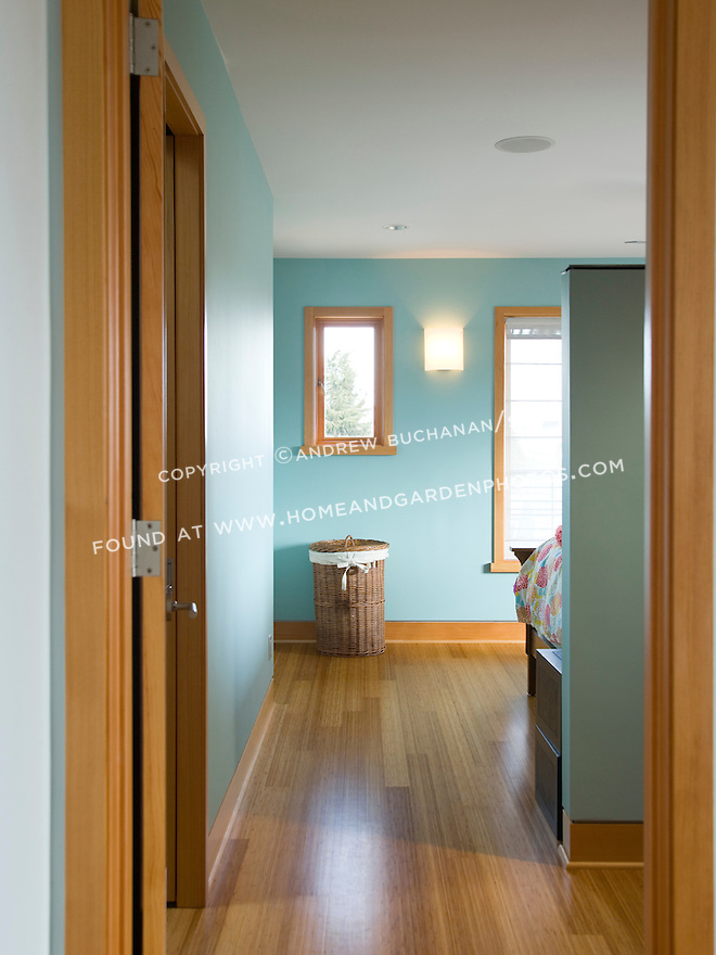 In this Seattle residential second floor addition, the upstairs Master Bedroom, hallway, and kids' rooms are floored with the same sustainable, bamboo engineered wood flooring as throughout the house, while doors and trim are clear fir.
