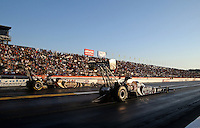 Feb. 17, 2013; Pomona, CA, USA; NHRA top fuel dragster driver Shawn Langdon (near lane) races alongside Khalid Albalooshi during the Winternationals at Auto Club Raceway at Pomona. Mandatory Credit: Mark J. Rebilas-