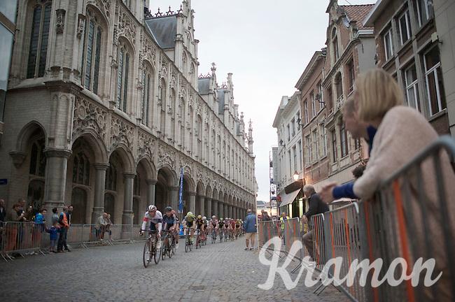 peloton cruising along City Hall<br /> <br /> Post-Tour Criterium Mechelen (Belgium) 2016