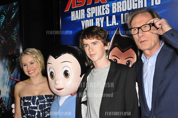 """Kristen Bell, Freddie Highmore & Bill Nighy with Astro Boy character at the Los Angeles premiere of their new animated movie """"Astro Boy"""" at Grauman's Chinese Theatre, Hollywood..October 19, 2009  Los Angeles, CA.Picture: Paul Smith / Featureflash"""