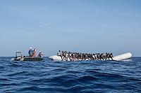 Sea Watch-2.<br /> Die Sea Watch-2 bei ihrer 13. SAR-Mission vor der libyschen Kueste.<br /> Im Bild: Ein Schlauchboot mit ca. 160 Menschen wird von der Sea Watch-Crew betreut.<br /> 20.10.2016, Mediterranean Sea<br /> Copyright: Christian-Ditsch.de<br /> [Inhaltsveraendernde Manipulation des Fotos nur nach ausdruecklicher Genehmigung des Fotografen. Vereinbarungen ueber Abtretung von Persoenlichkeitsrechten/Model Release der abgebildeten Person/Personen liegen nicht vor. NO MODEL RELEASE! Nur fuer Redaktionelle Zwecke. Don't publish without copyright Christian-Ditsch.de, Veroeffentlichung nur mit Fotografennennung, sowie gegen Honorar, MwSt. und Beleg. Konto: I N G - D i B a, IBAN DE58500105175400192269, BIC INGDDEFFXXX, Kontakt: post@christian-ditsch.de<br /> Bei der Bearbeitung der Dateiinformationen darf die Urheberkennzeichnung in den EXIF- und  IPTC-Daten nicht entfernt werden, diese sind in digitalen Medien nach §95c UrhG rechtlich geschuetzt. Der Urhebervermerk wird gemaess §13 UrhG verlangt.]
