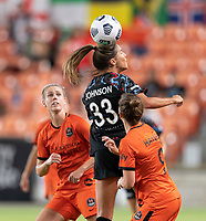 HOUSTON, TX - SEPTEMBER 10: Katie Johnson #33 of the Chicago Red Stars heads the ball over Haley Hanson #9 of the Houston Dash during a game between Chicago Red Stars and Houston Dash at BBVA Stadium on September 10, 2021 in Houston, Texas.