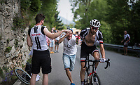 Laurens ten Dam (NED/Sunweb) grabbing a last botlle up the Foza climb (1086m) while being pushed by a fan<br /> <br /> Stage 20: Pordenone › Asiago (190km)<br /> 100th Giro d'Italia 2017
