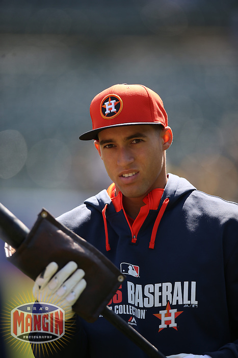 OAKLAND, CA - APRIL 19:  George Springer #4 of the Houston Astros takes batting practice before the game against the Oakland Athletics at O.co Coliseum on Saturday, April 19, 2014 in Oakland, California. Photo by Brad Mangin