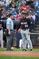 Home plate umpire Blake Felix talks with New Britain Rock Cats interim manager Ron Gideon (45) during a game against the Akron RubberDucks on May 21, 2015 at Canal Park in Akron, Ohio.  Akron defeated New Britain 4-2.  (Mike Janes/Four Seam Images)